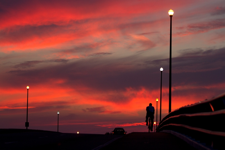 A colorful sunrise greets traffic crossing the Booker T. Washington Bridge on Settler's Landing Road in Hampton Wednesday. (Photo By Adrin Snider)