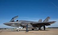 """An F-35C """"Lightning II"""" Joint Strike Fighter aircraft sits on the runway after landing at NAS Oceana on Tuesday in Virginia Beach. (Kaitlin McKeown)"""