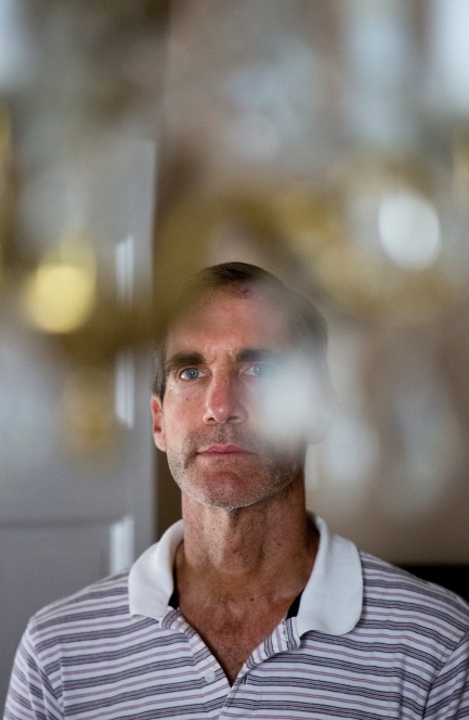 """Jim Garner, 52, was diagnosed in 2011 with """"mild cognitive impairment,"""" the precursor to Alzheimer's Disease. The genetically-predetermined disease took the lives of both his mother, at age 61, and older brother, at age 52. After several years of intensive experimental treatments, the Garner family has taken a step back from the rigor of regular clinical trials. Although Jim occasionally infuses conversations with characteristic humor, he sometimes struggles now to find the right words. (Kaitlin McKeown)"""