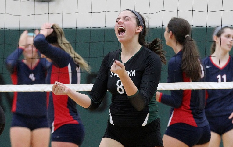 Jamestown's Ellie Popelka celebrates after getting the match winning point over Grafton in the fifth game of the Conference 19 volleyball championship Thursday at Jamestown.