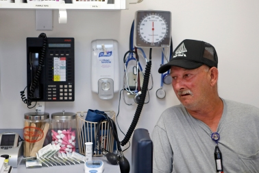 Tangier Island resident Joseph Charnock waits for treatment at the Riverside Tangier David B. Nichols Health Center Thursday afternoon. (Jonathon Gruenke)