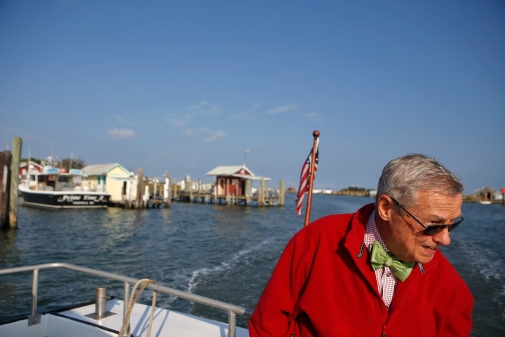 Dr. David Kemp looks over Tangier Island as he approaches the marina by boat Thursday morning. Dr. Kemp visits the island every other week to treat patients at the Riverside Tangier David B. Nichols Health Center. (Jonathon Gruenke)