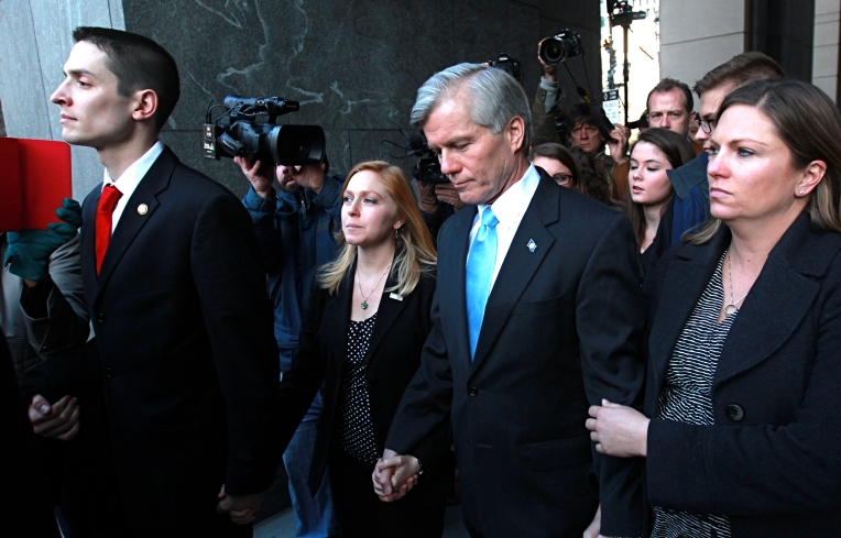 Former Virginia governor Bob McDonnell walks out of the federal court building in Richmond after being sentenced to two years for corruption Tuesday. (Rob Ostermaier)