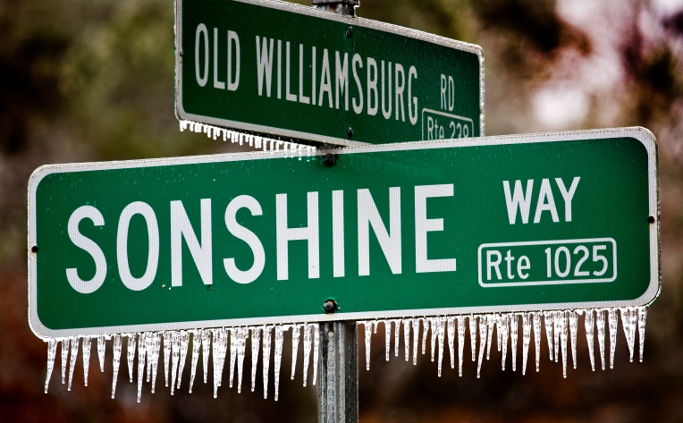 A street sign on Rt. 238 / Old Williamsburg Rd. near Lacky in York Co. tills the story of icy rain.