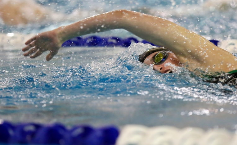 Jamestown High School senior Taylor Vitaletti swims the 50 freestyle during the 4A South Regional swim meet at the Midtown Community Center on Monday in Newport News. (Kaitlin McKeown) For more.