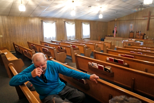 Buddy Pierce, a deacon a Maranatha Southern Baptist Church, sits in a pew and reflects on memories. The church is set to be demolished because it stands in the route of VDOT's plan to build a 460 bypass to the north of Windsor. (Jonathon Gruenke)