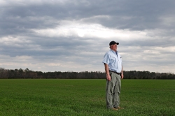 Billy Gwaltney stands on his farmland where VDOT plans to build a 460 bypass to the north of Windsor. The new route would effect 1.2 miles of his property.