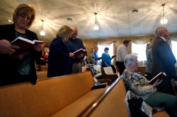 Maranatha Southern Baptist Church members sing during their Sunday morning worship. The church is set to be demolished because it stands in the route of VDOT's plan to build a 460 bypass to the north of Windsor. (Jonathon Gruenke)