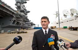 "Commander CSG 12 Rear Adm. Andrew ""Woody"" Lewis addresses the media on the delayed deployment of the USS Theodore Roosevelt Monday."