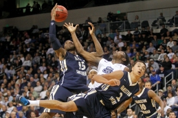 Old Dominion University's Denzell Taylor, center, battles for rebound with Charleston Southern's Paul Gombwer, left, and Aaron Wheeler, right, and during the first round of the NIT tournament Wednesday evening at the Constant Center in Norfolk. (Jonathon Gruenke)