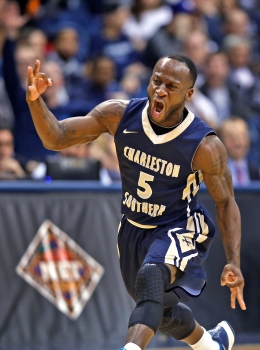 Charleston Southern's Saah Nimley celebrates hitting a three point shot during the first round of the NIT tournament Wednesday evening against Old Dominion University at the Constant Center in Norfolk. (Jonathon Gruenke)