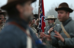 American Civil War re-enactors dressed as members of the North Carolina 26th Infantry receive final instructions before taking part in a re-enactment of the Battle of Appomattox Court House at the Appomattox Court House National Historical Park April 9, 2015 in Appomattox, Virginia. Today is the 150th anniversary of Confederate General Robert E. Lee's surrender of the Army of Northern Virginia to Union forces commanded by General Ulysses S. Grant in the McLean House at Appomattox, Virginia. The surrender marked the beginning of the end of the American Civil War in 1865. (Photo by Win McNamee/Getty Images)