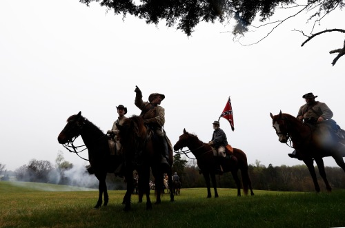 Confederate officers direct troops during a re-enactment of the Battle of Appomattox Courthouse as part of the commemoration of the 150th anniversary of the surrender of the army of Northern Virginia at Appomattox Court House in Appomattox, Va., Thursday, April 9, 2015. The battle was the final battle of the army of Confederate General Robert E. Lee before his surrender to Union troops. (AP Photo/Steve Helber)