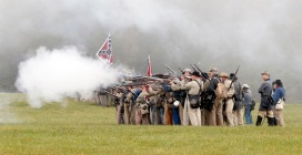 Confederate troops fire on Union troops during a re-enactment of the Battle of Appomattox Courthouse as part of commemoration of the 150th anniversary of the surrender of the Army of Northern Virginia at Appomattox Court House in Appomattox, Va., Thursday, April 9, 2015. The battle was the final battle of the army of Confederate General Robert E. Lee before his surrender to Union troops. (AP Photo/Steve Helber)