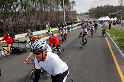 Dozens of bicycles move along City Center Boulevard after Saturday's ribbon cutting ceremony and community celebration April 4, 2015. (Jonathon Grueke)