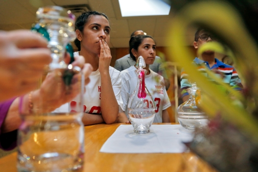 Lexi Yau, left, Alexandra Yau, center, and Alex Yau listen to instructions about the process of delivering oil to Father Sean Prince during a rehearsal for Holy Week at Immaculate Conception Catholic Church in Hampton. (Jonathon Gruenke)