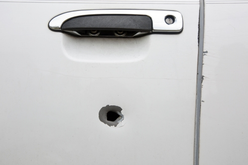 A bullet hole marks a vehicle near the scene of a homicide in the 800 block of 25th Street in southeast Newport News. Two teens, Jada Richardson, 13, and Domingo Santiago Davis Jr., 17, were shot and killed on Monday night. (Kaitlin McKeown)