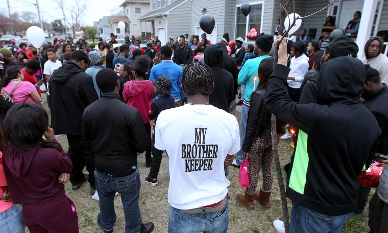 Friends and family of Jada Richardson and Domingo Santiago Davis Jr. hold a vigil for the two murdered teens outside the 25th street home where they were shot Monday night. (Rob Ostermaier)