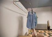 Shirts hang on a rack in the laundry room of the Youth Challenge Hope Center in Newport News. (Kaitlin McKeown)