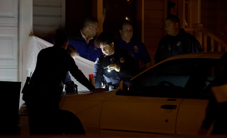 Police worked into the early morning hours Tuesday gathering evidence from the homicide scene. The deaths were the 11th and 12th of the year in the city of Newport News. (Adrin Snider)