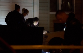 Police examine a 17-year old homicide victim, one of two in a double homicide late Monday evening. A 13-year old female was also killed. The deaths were the 11th and 12th of the year in the city of Newport News. (Adrin Snider)
