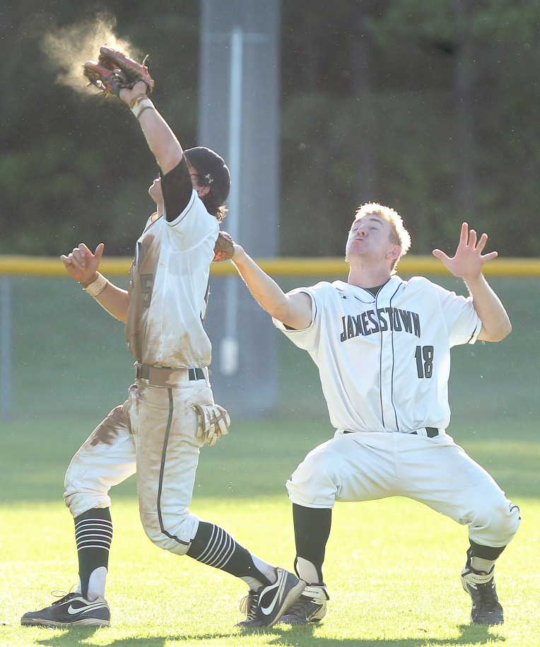 Jamestown's Evan Lowery backs up Roger Romero as he catches the final out against York Friday at Jamestown.
