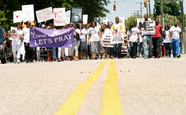 Parents and family of victims of violence march down Madison Ave. Saturday calling for an end to the murders that have plagued the area.