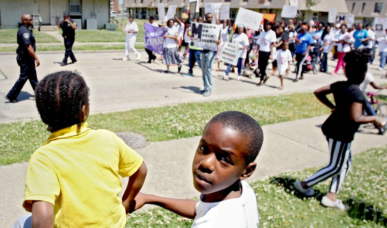 As children play a march to end the violence that has plagued the East End of Newport News makes its way down 35th street Saturday.