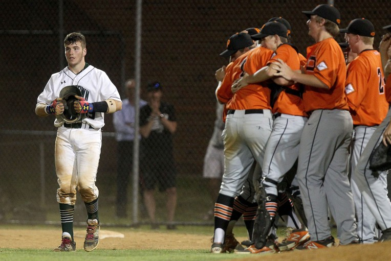 Jamestown's Kevin Mooney walks off the field after hitting into the last out against Powhatan in the seventh inning Tuesday. Powhatan advances in the Conference 19 tournament hater beating Jamestown 5-3.