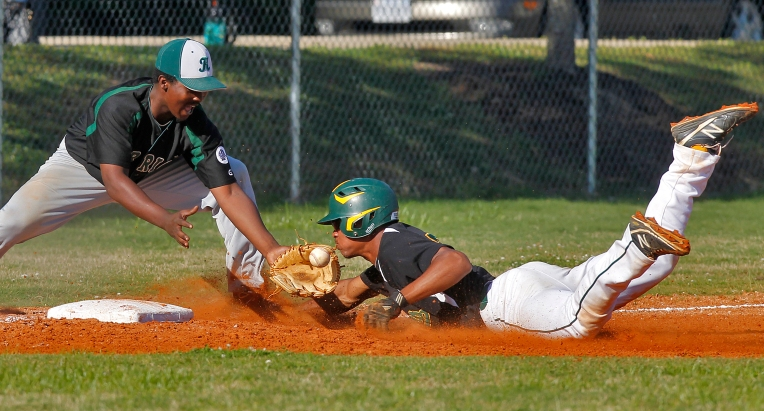 Bethel's J.C. Hardy slides safely into third as Kecoughtan's Ronnie Taylor bobbles the catch during Friday's game at Bethel.