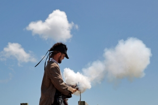 James Keefe fires a black powder gun during Saturday's Blackbeard Pirate Festival in Hampton.