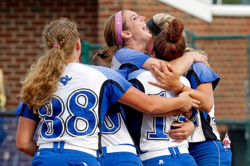 Christopher Newport University's Hanah Marshall, center, celebrates with teammates after getting the final out during Sunday's NCAA Division III regional tournament championship against Randolph-Macon on May 10, 2015.
