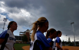 Christopher Newport University players head to the dugout as storm clouds approach the field during Sunday's NCAA Division III regional tournament championship against Randolph-Macon on May 10, 2015.
