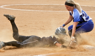 Christopher Newport University's Brittney Walters, right, tags out Randolph-Macon's Amanda Sopko during Sunday's NCAA Division III regional tournament championship on May 10, 2015.