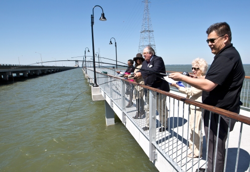 From left, Newport News City Council members Saundra Nelson Cherry, Sharon Scott, Herbert H. Bateman, Jr., Pat Woodbury and Vice Mayor Robert Coleman fish from the new James River Fishing Pier on Friday in Newport News.