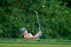 Lexi Thompson hits the ball out of a bunker on the 15th hole during the final round of the LPGA Kingsmill Championship on May 17, 2015.
