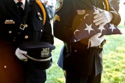 Newport News police officers wait to place the Flag, Boots and Hat during Thursday's candlelight memorial service to remember the 11 police officers who have died on duty and to honor those who serve today.