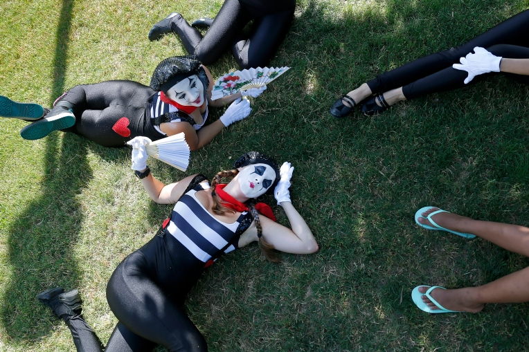 Brooke Jordan, center, Kereni Sanchez, and other mimes perform during Saturday's World Arts Celebration at City Center. The event featured various performances and international food.