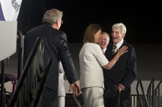 Jeanne Warner, center, and John Warner, right, share a moment after christening the submarine John Warner SSN 785 Saturday evening at Newport News Shipbuilding. To the left is Matt Mulherin, President of Newport News Shipbuilding and in the background is Ray Mabus, Secretary of the Navy. (Photo by Jonathon Gruenke/Daily Press)