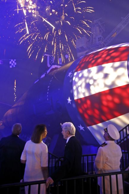 From left, Matt Mulherin, President of Newport News Shipbuilding, Jeanne Warner, John Warner and Commander Dan Caldwell watch as fireworks fill the sky after christening the submarine John Warner SSN 785 Saturday evening at Newport News Shipbuilding. (Photo by Jonathon Gruenke/Daily Press)
