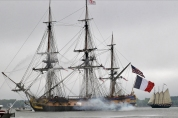 The French tall ship Hermione fires canons while as it approaches Yorktown Friday morning. (Jonathon Gruenke)