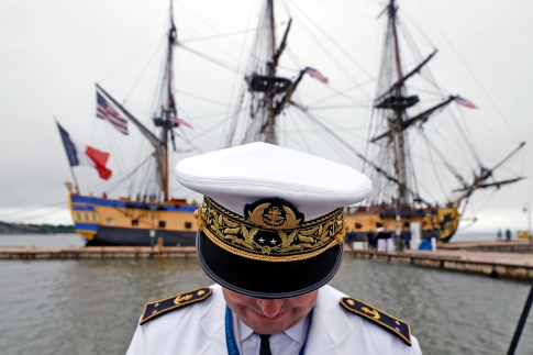Rear Admiral Heivé Blejean of the French Navy stands on the pier after the French tall ship Hermione docks at Yorktown Friday morning. (Jonathon Gruenke)
