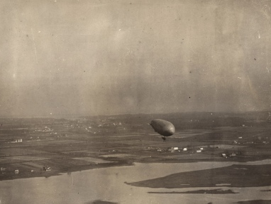 A Langley Field C-class airship flies over Mill Creek in Hampton in this early-20th-century photo. Credit: Courtesy of the Hampton History Museum