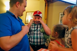Kyle Summerfield, center, listens to the heart of Albert Kurtyka, left, Friday evening at Beach Bully Bbq in Virginia Beach. Kurtyka received the heart of Summerfield's father, William, 34, after he died in a car accident in January 2014.