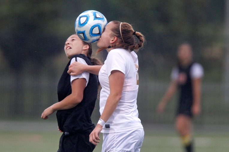 Lafayette's Mackenzie Wilson, right, attempts to head the ball away from Brentsville's Olivia Simmons during Wednesday's game at Wanner Stadium.