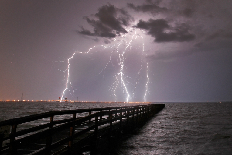 Lightning flashes over the James River as severe thunderstorms move through Hampton Roads Tuesday evening.