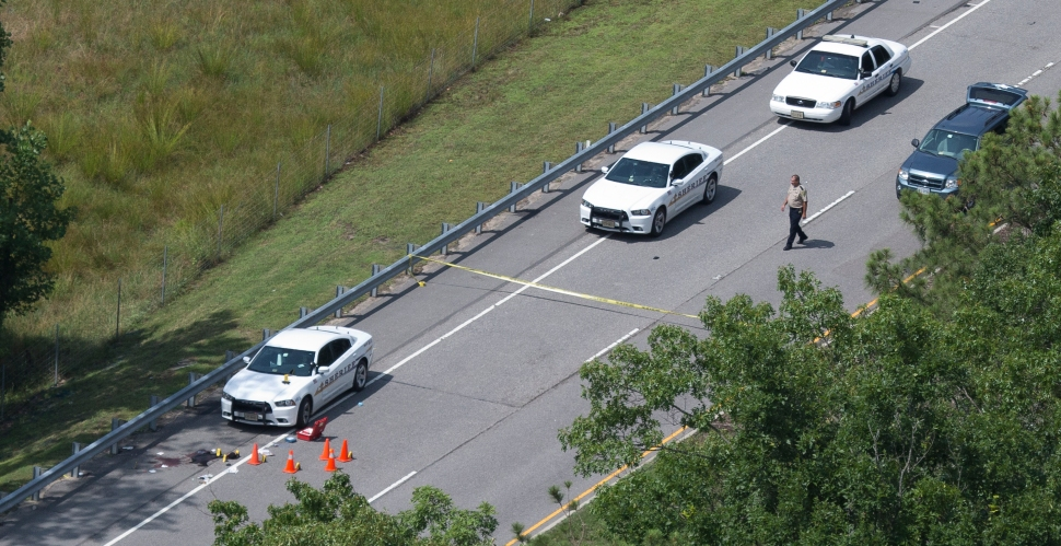 Police investigate where York Poquoson Sheriffs Department deputy fatally shot a man wanted in Newport News.