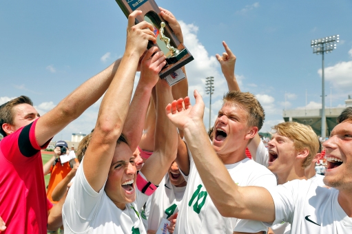 Jamestown's Ben Carper, center, left, Davis Wood, center right, and other teammates celebrate after defeating Hanover 3-0 during Saturday's 4A state championship soccer game at Liberty University in Lynchburg.