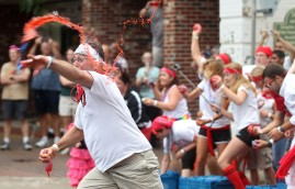 Larry Parks throws a water-balloon after the annual Rolling of the Bulls in the downtown Hampton Saturday.