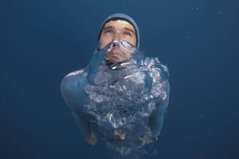 TO GO WITH AFP STORY BY EMMANUEL BARRANGUET French free diver Guillaume Nery practices apnea during a training session in the Mediterranean sea near Nice on July 18, 2015, ahead of the 2015 AIDA (Association for Development of Apnea) Individual Depth World Championships which will take place between September 5 and 20 in Cyprus. AFP PHOTO / BORIS HORVATBORIS HORVAT/AFP/Getty Images ORG XMIT: 6932